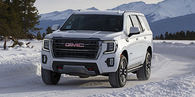 New 2021  GMC Yukon 4WD 4dr AT4 at Charbonneau Car Center near Dickinson, ND